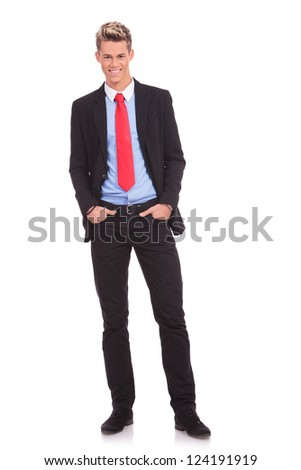young business man standing with his hands in the pockets