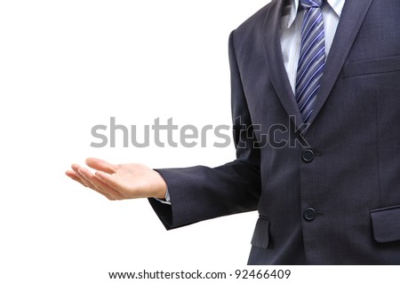 Young business man standing with open hand isolated on white - stock photo