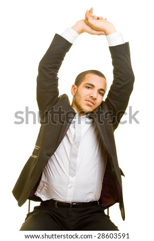 Young business man stretching on a chair - stock photo