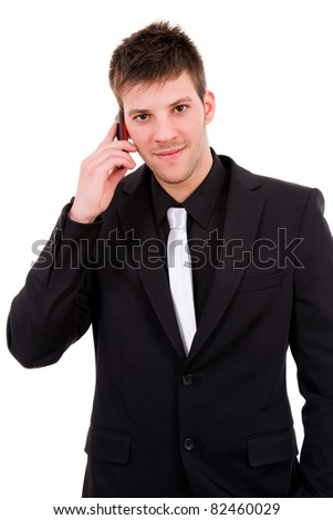 Young business man talking at the mobile phone, isolated over white