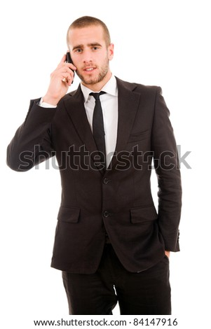 young business man talking on mobil phone, isolated on white - stock photo