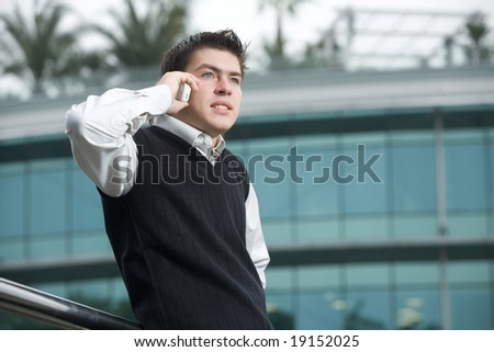 Young business man talking on phone - stock photo