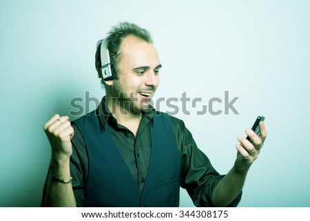 young business man talking on the phone in the headphones, Skype Manager office concept, shot isolated on gray background - stock photo