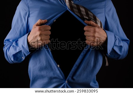 Young business man tearing his shirt off with copy space - stock photo
