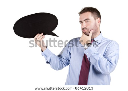 young business man thinking and holding a speech balloon over white background - stock photo