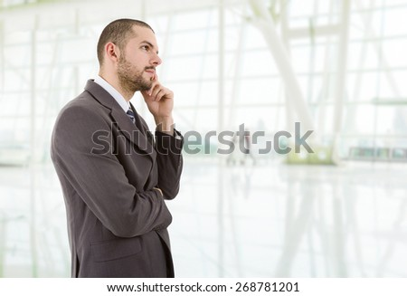 young business man thinking at the office - stock photo