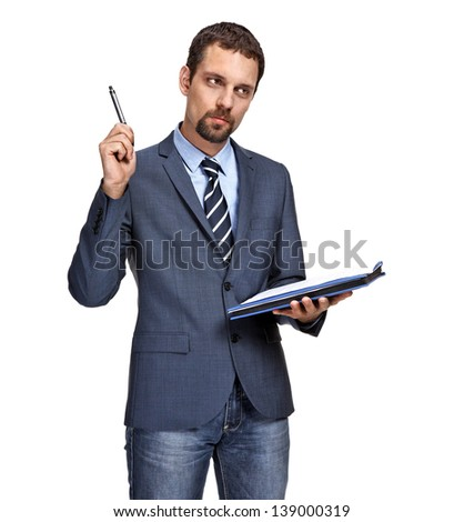 Young business man thinking while writing notes isolated over white background  - stock photo