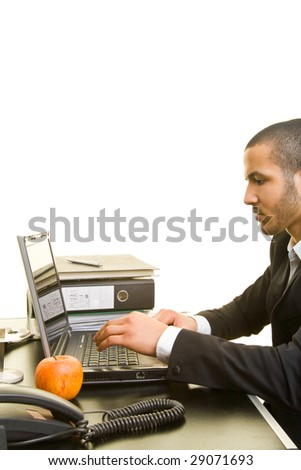 Young business man typing on a laptop - stock photo