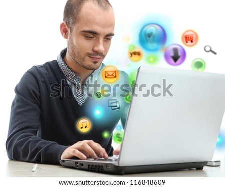 Young business man using his laptop for multimedia and site surfing. Different icons appearing from the screen isolated - stock photo