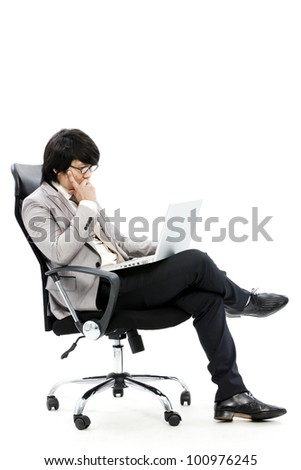young business man using new laptop and thinking