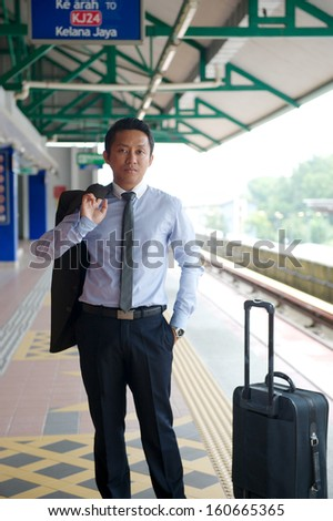 Young business man waiting train