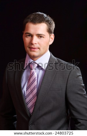 Young business man wearing suit with tie - stock photo