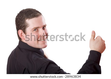 Young business man wearing suit with tie giving ok gesture isolated