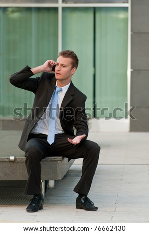 Young business man with a telephon - stock photo