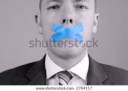 Young business man with adhesive tape. Picture was made in a studio - stock photo