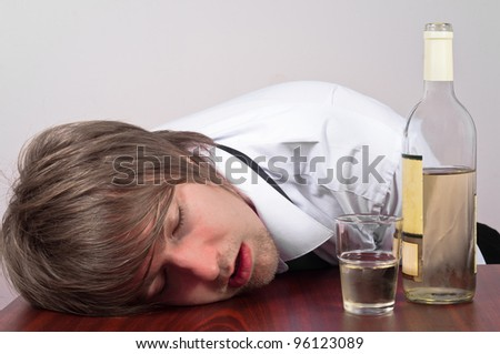 Young business man with alcohol - stock photo