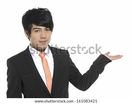 Young business man with arm out in a welcoming gesture
