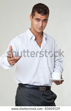 Young business man with cup of coffee - stock photo