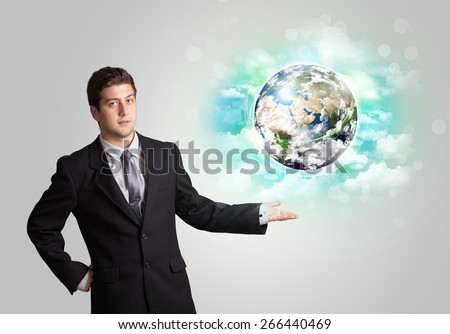 Young business man with earth and cloud concept
