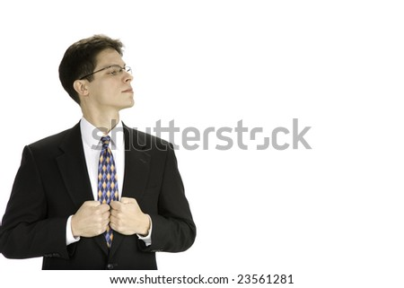 Young business man with head turned sideways with attitude. - stock photo