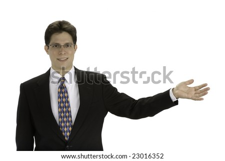 Young business man with his hand held out - stock photo