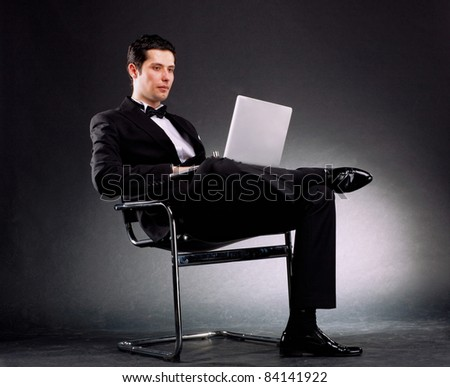young business man with laptop - stock photo