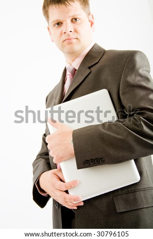 Young business man with laptop computer on white background - stock photo