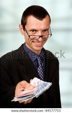 young business man with money at the office