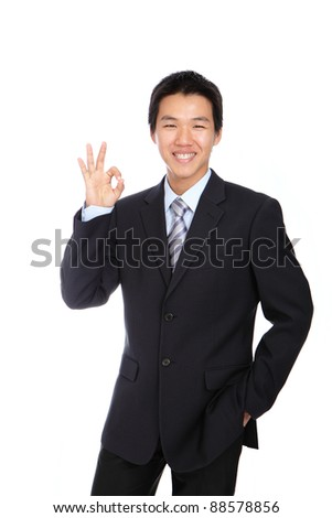 Young Business Man with OK hand gesture , isolated on white background