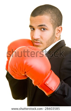 Young business man with red boxing gloves - stock photo