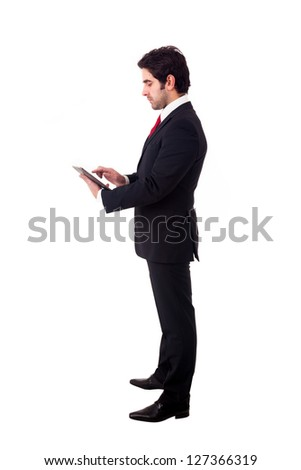 Young business man with tablet computer. Isolated over white background. - stock photo