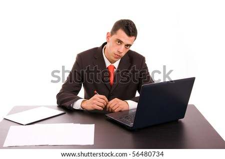 Young business man working on a desk with a laptop