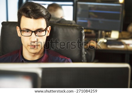 Young business man working on computer in office. - stock photo