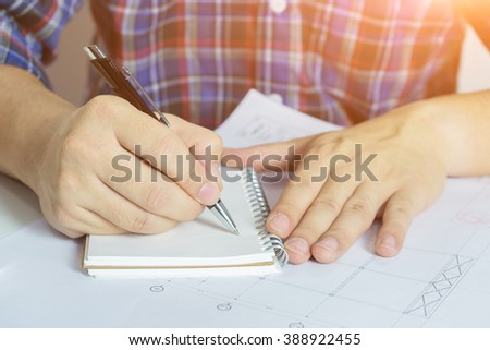 Young Business man  working,Signing Contract forms,Man writing paper at the desk,Student writing with pen and reading books at table,Signing, Contract, Form. in office ,morning light ,selective focus. - stock photo