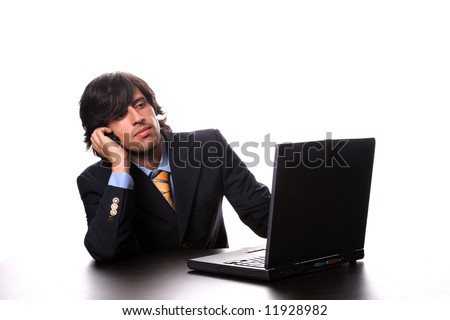 young business man working with his laptop and calling on cellphone, isolated on white background