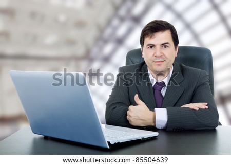 young business man working with is laptop - stock photo