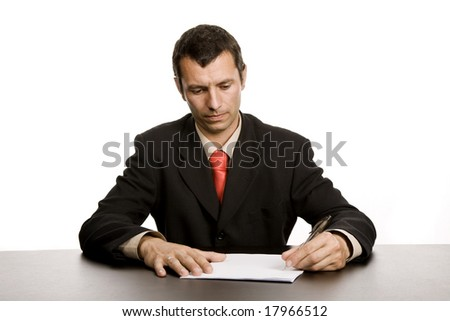 young business man writing on a desk - stock photo