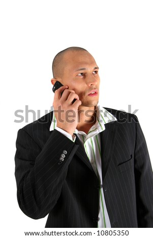 Young Business Man Young man in suit is using his cell phone. Isolated over white. - stock photo