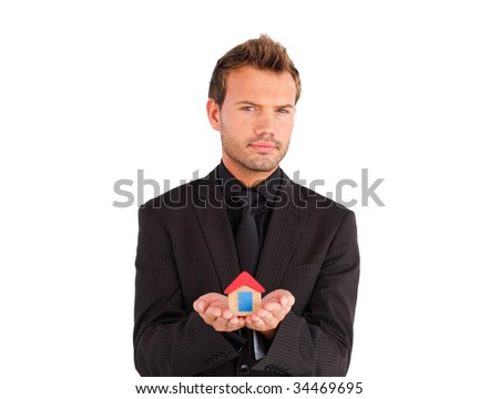 Young business manager holding house in his hands