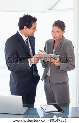 Young business partner looking at tablet in their hands - stock photo