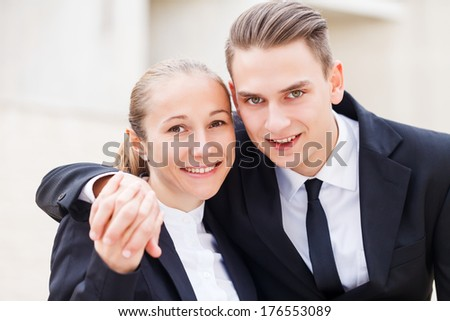 Young business partners fall in love with each others at work - stock photo