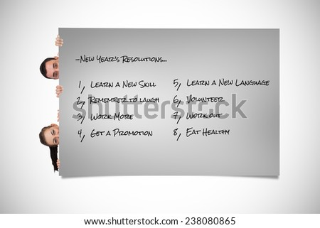 Young business partners looking around the corner against grey card - stock photo