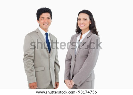 Young business partners standing together against a white background