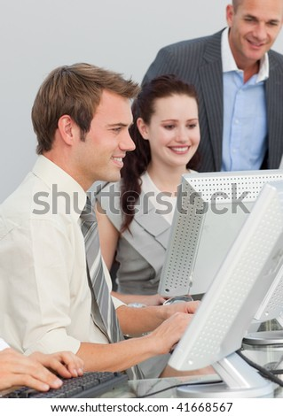 Young business people and manager working with computers in an office