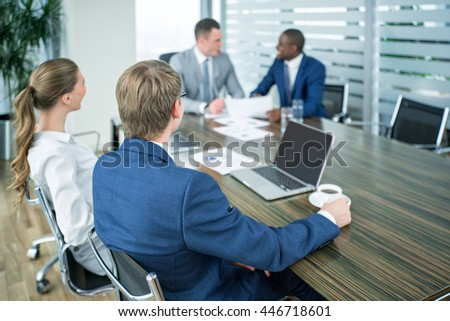 Young business people at meeting in office