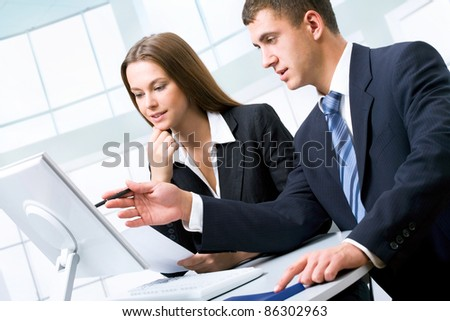 Young business people at office - stock photo