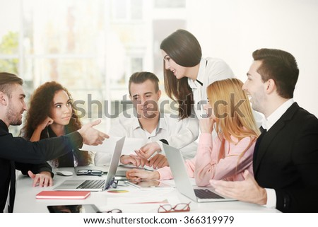 Young business people discussing a new project in a conference room - stock photo
