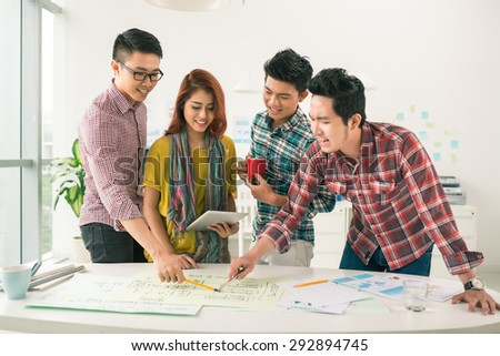 Young business people discussing new business strategy - stock photo