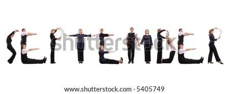 Young business people forming September word over white - business calendar concept - stock photo