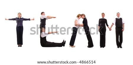 Young business people forming Team word over white - stock photo